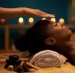pic of woman getting reiki energy medicine over face