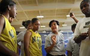 pic of girls b-ball team coach huddle